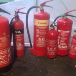 A lot of fire extinguishers